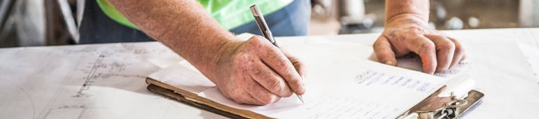 Man Signing a Construction Contract